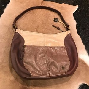 The Sak tan and brown leather purse
